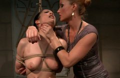 Svelte brunette doxy gets her bald vagina and big jugs pinned with pegs in BDSM
