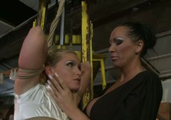 Submissive blonde girl is tied up and hanged down the ceiling. BDSM