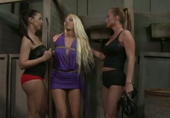 Curvy blonde babe is punished by two filthy mistresses