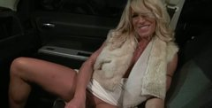 Voluptuous mom Gina is fondling her pussy in the car