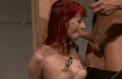 Slender red-haired slut gets her pussy lips tied with a rope