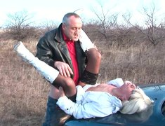 Spoiled blond mature gets fucked hard lying on car hood outdoor