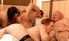 Two immense moms make out with their lovers in group sex orgy
