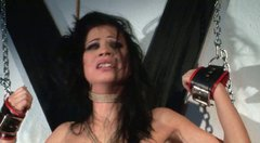 Shabby looking brunette hussy gets her tits pinned with metal pins