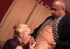 Dirty-minded blond secretary Ellis provides black boss with a blowjob