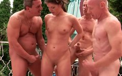 Whorish brunette hussy gets her face splattered with urine in gangbang