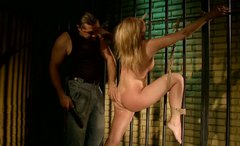 Blindfolded and tied up blondie stands on knees and sucks a strong dick