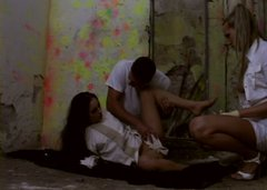 Mad brunette in straitjacket gets poked from behind in steamy threesome