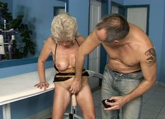Horny granny with big tits gets her pussy drilled by a dildo machine