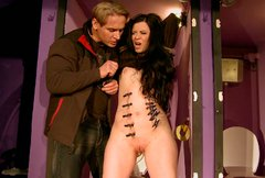 Slender brunette whore gets her body pinned with clothing pegs in BDSM