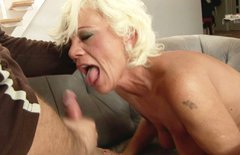 Busty mature blonde gives blowjob and rides on cock