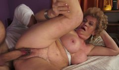 Ugly fat and wrinkled whore with huge saggy tits gives a blowjob for cum