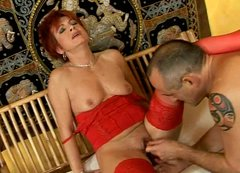Red haired mature mommy in red lingerie is toy fucked hard