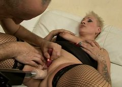 Lewd blond mature gets her gaped vagina pounded by dildo machine