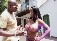 X-rated porn star Vanessa Blue in fishnet outfit is pumping cock outdoor