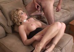 Sexploitress blond mom gives footjob and later blowjob to stiff cock of young lover