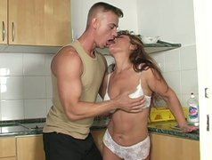 Sexually charges mature mommy is face fucked in the kitchen