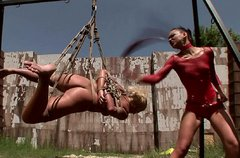 Sophisticated domina puts clothing pegs on curvy blondie in BDSM video