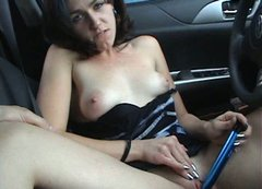 Hot tempered brunette enjoys masturbating in her car