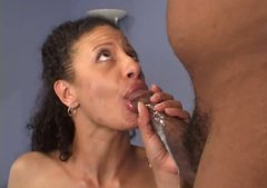 Curly-haired temptress gets fucked in both holes doggy style