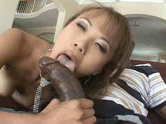 Cute Asian slut gives a solid blowjob to BBC and rides it passionately