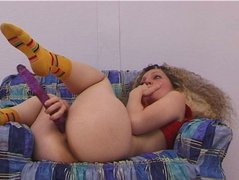 Curly-haired blonde sweety shows her love for masturbation