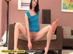 Sensual petite teen Lien pissing on chair