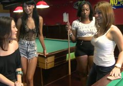 Whorish brunette plays billiard and flashes her tits in public