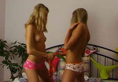 Two blond haired teeny gals get busy with teasing each other's fresh cunts