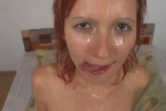 Provocative redhead slut is getting her face messed up in filthy pissing on face porn scene