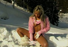 Tanned blonde girl dildo fucks her slit in the snowy forest