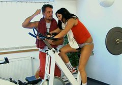 Athletic brunette babe is screwed doggy style fucking hard in a gym