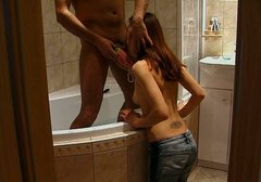Spoiled skinny brunette lures her BF in the bathroom and sucks his dick
