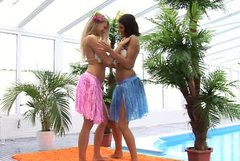 Tempiting babes wearing Hawaii style costumes are having passionate lesbian sex on cam