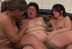 Three old  moms please each other in the small pool