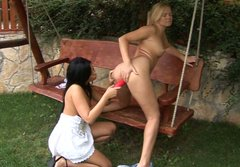 Charming lesbians Jasmine & Isabel use a pink dildo for drilling each other's twats