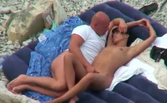 Two sex greedy adults make out in sideways pose at the beach in reality sex scene