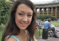 Adorable brunette girl gives a head on a red square