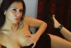Incredible beautiful brunette seductress is masturbating on webcam