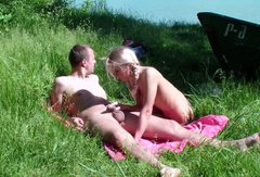 Blonde cutie is in the mood to give blowjob outdoors