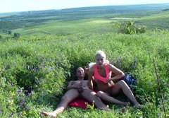 Beautiful Russian honey rides her boy's big long dick in the field