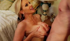 Busty mature blonde Julia An gives head and titjob