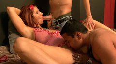 Curvy red-haired mom takes part in steamy gangbang sex party