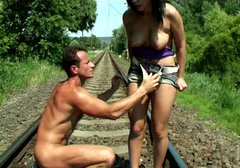 Buxom hottie with smooth ass Allisa sucks a dick right on the railroad