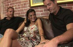 Two bisexual guys are having fun with one gorgeous brunette