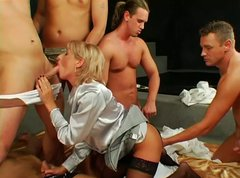Slutty blond milf oral fucks bunch of horny dudes in turns