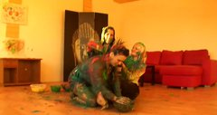Severe paint covered brunette chicks have a catfight on the floor