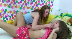 Two playful amateur lesbians rub each other's bushy pussies with lollipop