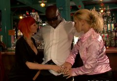 Slutty blondie and tipsy redhead sucks the black dude's dick in the bar