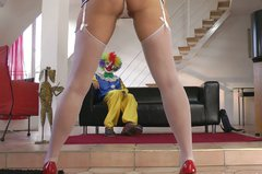 Spoiled tall British filth Lara Latex seduces a clown for being fucked doggy
